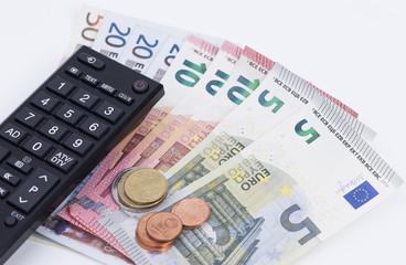 Fernbedienung und Geldscheine