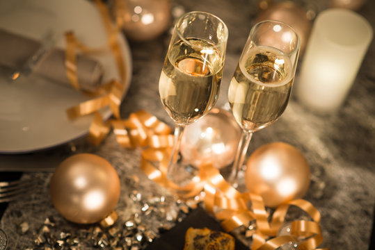 new years eve party table with champagne flute ribon glitter