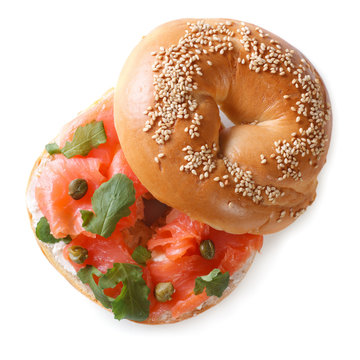 bagel with red fish and soft cheese isolated top view