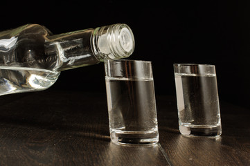 Original crooked design vodka shots isolated