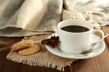 Cup of coffee with cookies, star anise and cinnamon