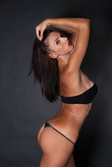 Attractive brunnete with thong and bra posing on chair