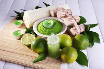 Spa composition with lime and bowl of sea crystals