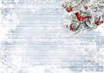 Wooden background with firtree, holly, bird,snowflake