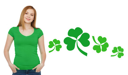 smiling teen girl in green t-shirt with shamrock