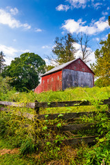 Fence and barn on a farm in rural York County, Pennsylvania.