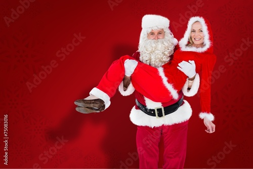 Composite Image Of Santa And Mrs Claus Smiling At Camera