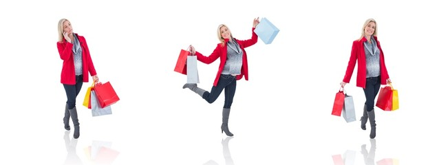 Happy blonde in winter clothes holding shopping bags