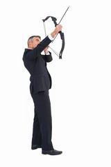 Elegant businessman stretching a bow