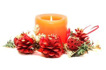 xmas orange candle with red pine cone decoration