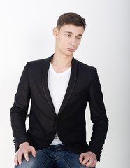 male model in suit with sports shirt