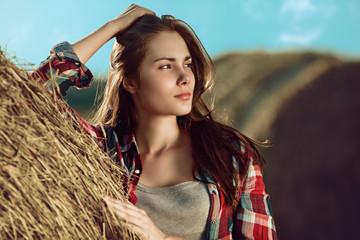Girl next to haystack