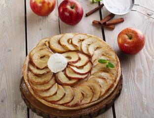 Open apple pie puff pastry with ice cream