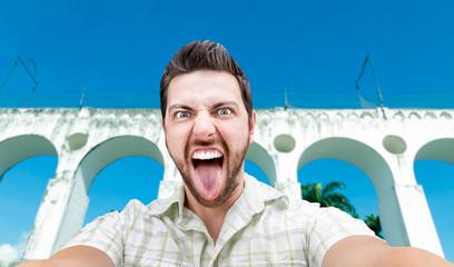 Happy young man taking a selfie photo in Rio de Janeiro, Brazil