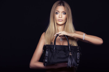 Attractive blonde woman with bag