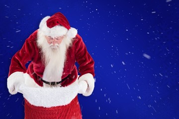 Composite image of santa looks in his bag