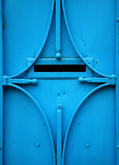 Detail of a blue door with mailbox