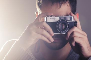 Man holiding retro camera