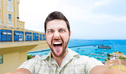 Happy young man taking a selfie photo in Bahia, Brazil