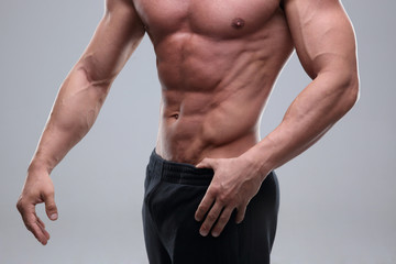Close up on perfect abs. Strong bodybuilder with six pack