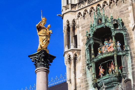 Statue of mother Mary on Munich's Marienplatz opposite a detail
