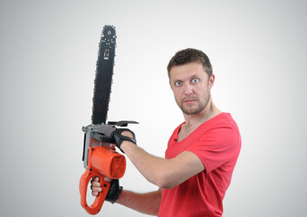Man with electric saw on background