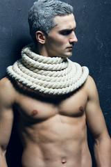 Snow Adonis fashion beauty concept. Portrait of muscle & undress