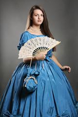 Beautiful woman wearing blue elegant costume