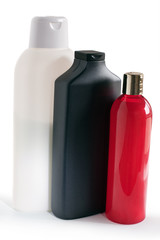 colored plastic bottles with shampoo