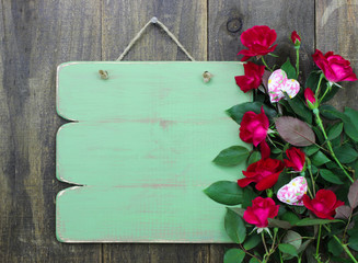 Blank wood green sign with red roses border