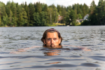 Swimming training of sportsman in lake