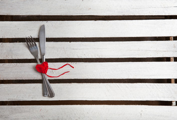 Concept image for Valentine dining, fork, knife and red heart