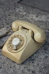 brown old phone vintage style on a floor.
