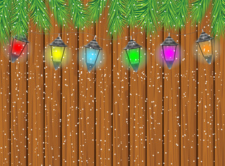 festive garland with varicoloured lanterns on a wooden backgroun