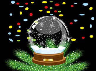 glass festive ball and varicoloured confettis on a black backgro