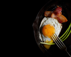 fried eggs with bacon and onions
