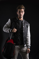 Man in Trendy Outfit Wearing University Jacket with Sport Bag