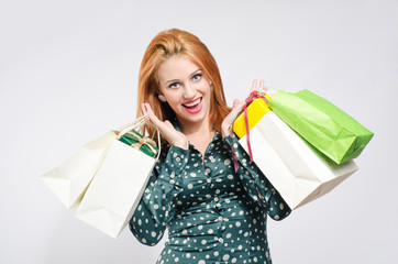 Girl with many shopping bags and gifts shopping for the holidays