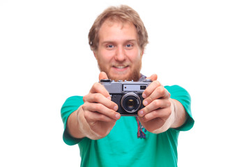 Portrait of cheerful photographer with camera