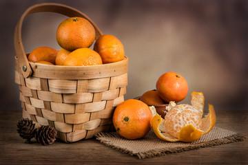 Still life with fresh mandarins in a basket