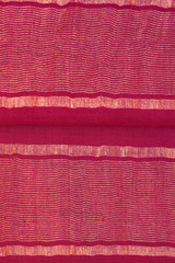 red silk textile with golden lines