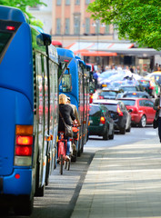 Buses and bikes in traffic