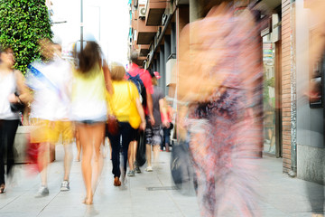 Motion blurred shoppers. Long time daytime blurred shot.