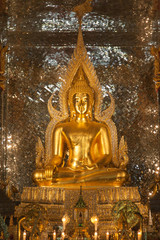 gold buddha statue in church at buddhist temple in Thailand