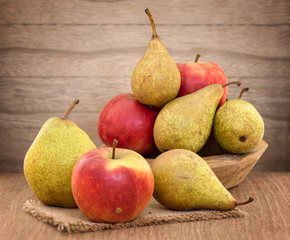 Pears and apples on wood table