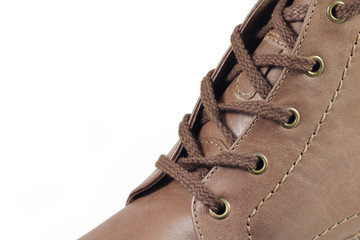 brown winter boots with laces on a white background