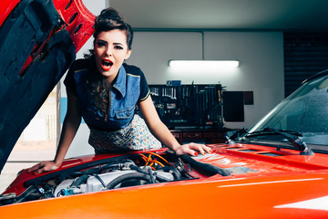 beautiful young woman surprised in car garage