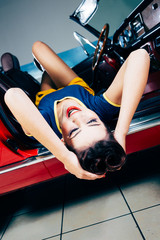 Smiling pinup in vintage car