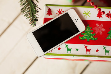 White smartphone with the christmas tree in background