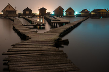 Magnificent long exposure lake at night with fishing houses